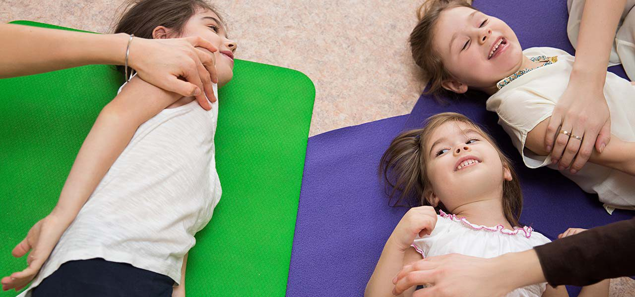 mothers do massage daughters at the gym on mats